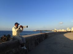A must do in #Havana #Cuba - Walk along the 8-kilometer Malecón. It's where Habaneros go to chill, fish, dance, play music, socialize, neck, and more. If you're curious about #travel to Cuba, check out my blog www.heidisiefkas.com and book #CubicletoCuba.