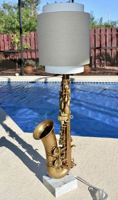 All new lamp parts, tested after assembly. Base is made from a composite stone. Shade in pictures is for display only and is NOT INCLUDED with lamp. Bulb is also not included. Port Saint Lucie, Lamps For Sale, Saxophone, Musical Instruments, Musicals, Table Lamp, Industrial, Ceiling Lights, Stone