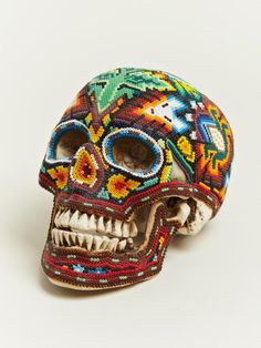 Our Exquisite Corpse: Beaded Skulls from Mexico. Coming from the country know for celebrating the Day of the Dead, each skull is created by the Huichol people of Western Mexico.