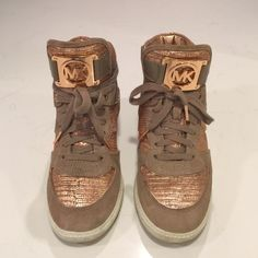 Michael Kors rose gold high top sneakers High top Michael Kors sneakers in rose gold. Have small platform on the inside of shoe! Super cute and comfortable. Only worn twice. Michael Kors Shoes Sneakers