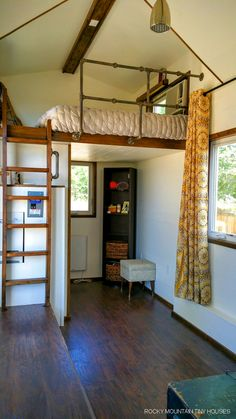 A 24′ tiny house on wheels in Albuquerque, New Mexico built using Structural Insulated Panels (SIP's) by Rocky Mountain Tiny Houses.