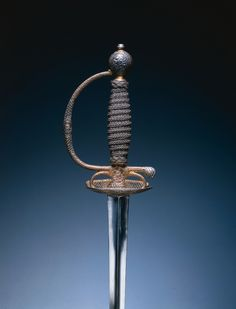 Small Sword, c. 1780 France, Paris (?), 18th century forged steel blade; partially gilt and russet steel hilt; steel wire, leather bands, wood core, Overall - l:103.50 cm (l:40 11/16 inches) Wt: .36 kg Blade - l:86.10 cm (l:33 7/8 inches) Guard - w:8.30 cm (w:3 1/4 inches).
