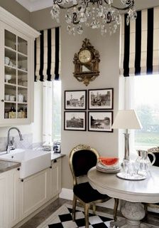 Paris kitchen. Elements: black & white; farmhouse sink; grey, taupe paint; glassfront cabinets, bling in chairs