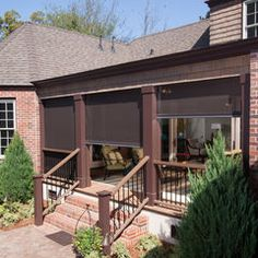 really like this porch with retractable screens - by Phantom Screens