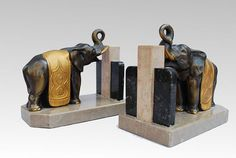 Hard to find art deco elephants book ends.  Patinated metal and marble. Circa 1930.  Excellent condition.