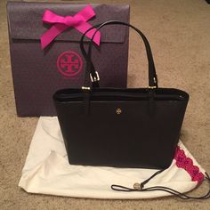 Tory Burch Small York Tote TB small York in black. Gold hardware, no stains or marks. Adjustable shoulder straps. One center zip, one small interior zip pocket. Four small interior pockets. Key hook inside. Comes with dustbag and gift bag. FOR MORE INFO and model pictures, PLEASE look at the Tory Burch website under small York tote!! Tory Burch Bags Totes