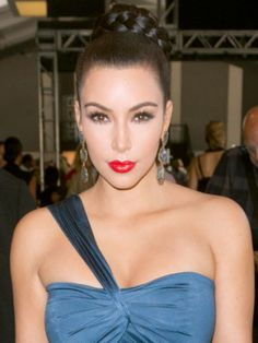 Leave it to Kim Kardashian to know exactly how to sex up a standard ballerina bun—with kiss-me crimson lips, cleavage, and thick braids.