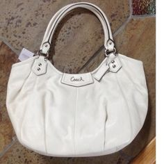 "Coach Ashley Leather Cream Shoulder Tote Beautiful Coach Ashley Cream Leather Tote, No. D1393-F23308. Perfect generously sized carryall measures 15"" long x 11.5"" high x 5"" wide.  Gently used a couple of times. A couple of light exterior marks, barely noticeable, interior like new. Lined in lavender fabric with silver hardware. Features 3 interior pockets, one zippered. No outer pockets, 9"" strap drop. Gorgeous!!!  Price is firm, no trades. Thanks for looking :) Coach Bags Totes"