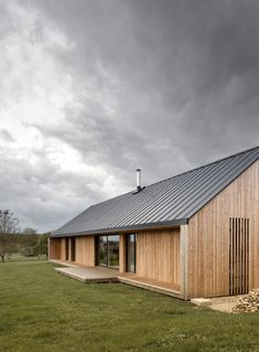 The Maison Simon, designed by Mathieu Noël & Élodie Bonnefous, is a private home in Vezet, France. Built in the village where the client began his career, the barn-like house showcases the owner's personal history through its architecture as. Architecture Design, Residential Architecture, Farmhouse Architecture, Architecture Interiors, Rural House, House In The Woods, Metal Building Homes, Building A House, Building Ideas