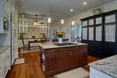 Kitchen and Breakfast room #customcabinets #hardwoodfloors #openspaces
