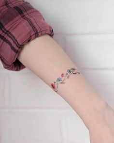 Five Questions To Ask At Pink Bracelet Tattoos Wrist Band Tattoo, Flower Wrist Tattoos, Tattoo Bracelet, Feather Tattoos, Flower Bracelet, Anklet Tattoos, Foot Tattoos, Body Art Tattoos, Feminine Tattoos
