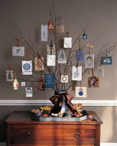 Each card you receive is like a little gift, carefully chosen by a friend or family member; as such, it deserves more than a passing glance and makeshift presentation. Suspend cards-turned-ornaments from dried winter branches in a bucket, vase, or other vessel; you don't need to add any water to enjoy this nature-inspired card display.