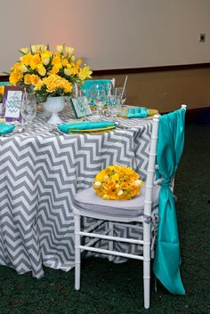 Chevron linen with yellow centerpieces - We have these grey chevron linens. So trendy and fun!!!
