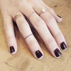 Minimalist ring tattoo on the right ring finger. Tattoo artist:...