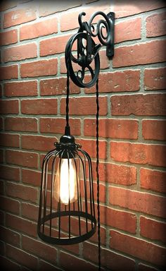 Items similar to SaLe! Cool Black Bird Cage Wall Pulley Light - Industrial - Farmhouse - Steampunk - Edison - Chic on Etsy Vintage Industrial Decor, Industrial Lighting, Rustic Decor, Industrial Farmhouse, Wall Hanging Lights, Wall Sconce Lighting, Ceiling Lights, Pully Light, Steampunk Interior