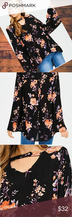 Black floral Boho top Sassy and sweet black floral Boho top.  Plunging fit it v-neck  with mock neck button closure straps.  100% rayon Tops