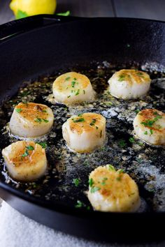 Pan seared sea scallops cooked in a cast iron skillet with a lemon and herb butter sauce. Sea scallops pan-seared in a cast iron skillet with a lemon and herb butter sauce. Fish Recipes, Seafood Recipes, Dinner Recipes, Cooking Recipes, Healthy Recipes, Cooking Tools, Clam Recipes, Cooking Games, Cooking Classes