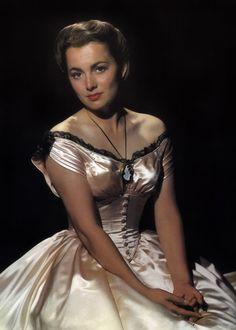 Olivia de Havilland - looks a lot like Cote de Pablo (Ziva on NCIS)