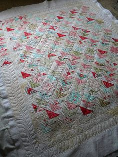 I love the quilting on this simple quilt. Pretty, girl colors.