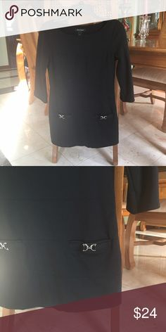 """WHBM KNIT TUNIC Trendy black Tiered knit tunic with side zip and 3/4 sleeves. Faux slash pocket with silver tone buckles. 28"""" length looks great with leggings or dress pants. Worn a few times and looks great White House Black Market Tops Tunics"""