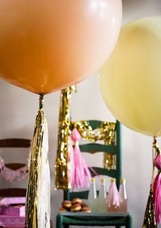 Helium Balloons covering the ceiling with glitter hanging off of them...
