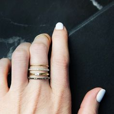 Gold banded rings with stones