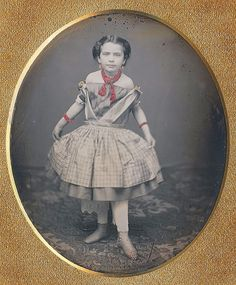 """This darling dancer holding her curtsy so beautifully for the camera is Georgiana Gardner. It is made personal and touching by a note on faded orange paper: """"My father's sister, who died at the age of twelve from scarlet fever."""" """"Written by Grace G. Hixon."""" We curtsy to you Georgiana with your clear blue eyes and graceful manner. Dance on, my dear! 1851"""