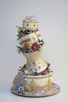 Ron Ben-Israel Wedding Cakes / http://www.deerpearlflowers.com/topsy-turvy-wedding-cake-ideas/