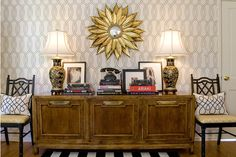 Handsome foyer design featuring walls of pale salmon working perfectly with a gold sunburst mirror hanging over an incredible black art deco credenza with gold inlay. Description from decorpad.com. I searched for this on bing.com/images