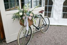 Bicycle baskets make for great outdoor wedding flower vessels