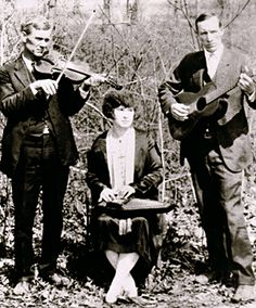 Appalachian mountain music. The seated woman is playing a dulcimer, which originated in Appalachia.