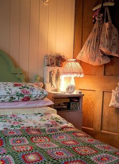 cottage style bed with pretty vintage bedding