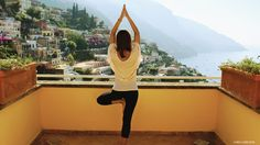 """Yoga Journal readers share snapshots of the yoga they practice during their travels. // """"When we arrived in Positano, Italy, for our honey-moon and opened up the balcony doors to this breathtaking view, I felt an overwhelming sense of serenity and love."""" —Kristina Valentini, Toronto, Canada"""