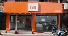 Xiaomi has set a Guinness World Record while simultaneous opening of 500 Mi Stores in India. The Chinese brand has plans to set uo 5000 Mi Stores in the year Tech Magazines, Rural India, Mobile Shop, Guinness World, World Records, Day, Retail Stores, Banks, Phones