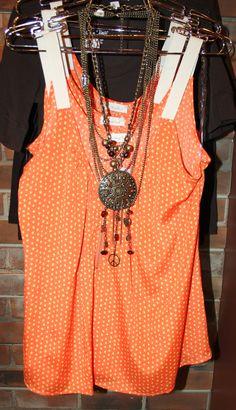 Bright and cheery, orange polka-dot top.