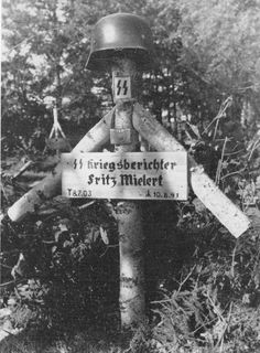The grave marker for Fritz Mielert, a Waffen-SS war correspondent on the Eastern Front, who was killed in action less than two months after the Nazi invasion of the Soviet Union in 1941