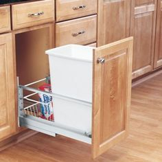 The door-mounted Pull-Out Waste Container by Rev-A-Shelf features brushed aluminum frames and soft closing slides that glide. Door mount hardware finishes the look and allows you to mount your existing cabinet door directly to the waste container. Shelves, Installing Cabinets, Kitchen Storage, A Shelf, Rev A Shelf, Kitchen Trash Cans, Kitchen Organization, Storage, Diy Kitchen