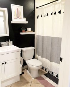 Black walls are a bold choice in a small bathroom – but they make a seriously stylish statement. This space features Clare's true black wall paint in Blackest.