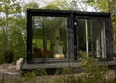 The Container Studio sees the clever use of two standard shipping containers perched over ...