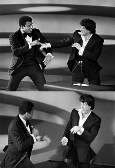 Muhammad Ali and Sylvester Stallone play-boxing at the Academy Awards, 1977.