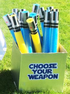 Star Wars party idea!  Light sabers made out of pool noodles.  I used a box and spray painted it silver and added a choose your weapon sticker.  I made one for the red light sabers as well.