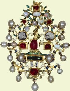 Sixteenth-century pendant with a serpent coiled around a tree and two skull cameos. (Royal Collection)