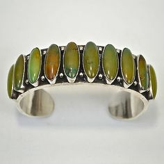Dean Brown Navajo Sterling Silver Manassa Turquoise 10 Stone Row Bracelet Cuff