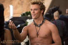 PHOTO: Finnick hands out sugar cube to Katniss in the new 'Catching Fire' Still