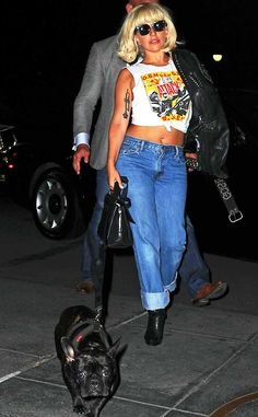 Rocking Out from Lady Gaga's One-of-a-Kind Street Style  Gaga takes a stroll with her dog, Asia, wearing denim jeans paired with a black leather jacket.