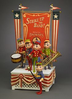 Released in NOW RETIRED. Palmer Cox Brownie Strike Up The Band Bandstand. Made exclusively for a special dinner event at the 2007 National UFDC Convention held in Detroit, Michigan. Antique Toys, Vintage Toys, John Wright, History Of Chocolate, Felt Banner, Paperclay, Felt Dolls, Classic Toys, Old Toys