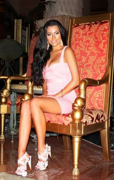 long hair brunette wavy hairstyle atlantis bahamas baby pink dress outfit heels gold