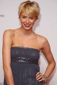 Short hair w/fringe (bangs). Perfect crop haircut and golden blonde color (though slightly brassy.) Lena Gercke