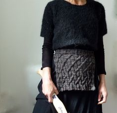 Ancestors Apron, hand-knitted in pure merino wool,.......... ........ ............. .......... I really like the black short sleeved over top.  Might be able to shorten a longer one for something similar.