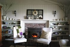 Fireplace, shelving, white walls & white room